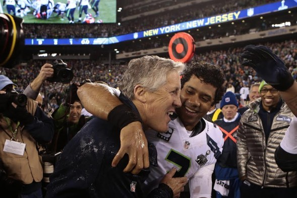 Russell Wilson, right, embraces head coach Pete Carroll after the Seahawks won the Super Bowl Sunday night. / Corky Trewin, Seattle Seahawks