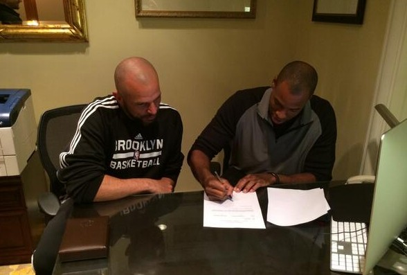 Signing a 10-day contract, Jason Collins mads history Sunday. / New Jersey Nets