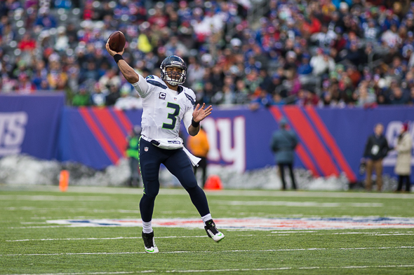 Russell Wilson and the Seahawks played at Metlife Stadium two months ago. They chose the same uniforms they had in that 23-0 win for Sunday's Super Bowl. / Drew McKenzie, Sportspress Northwest