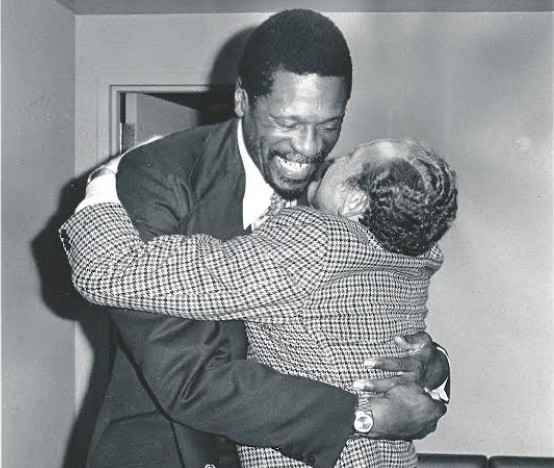 Bill Russell, who coached Haywood in Seattle and ultimately traded him to the Knicks, hugs owner Sam Schulman. / David Eskenazi Collection