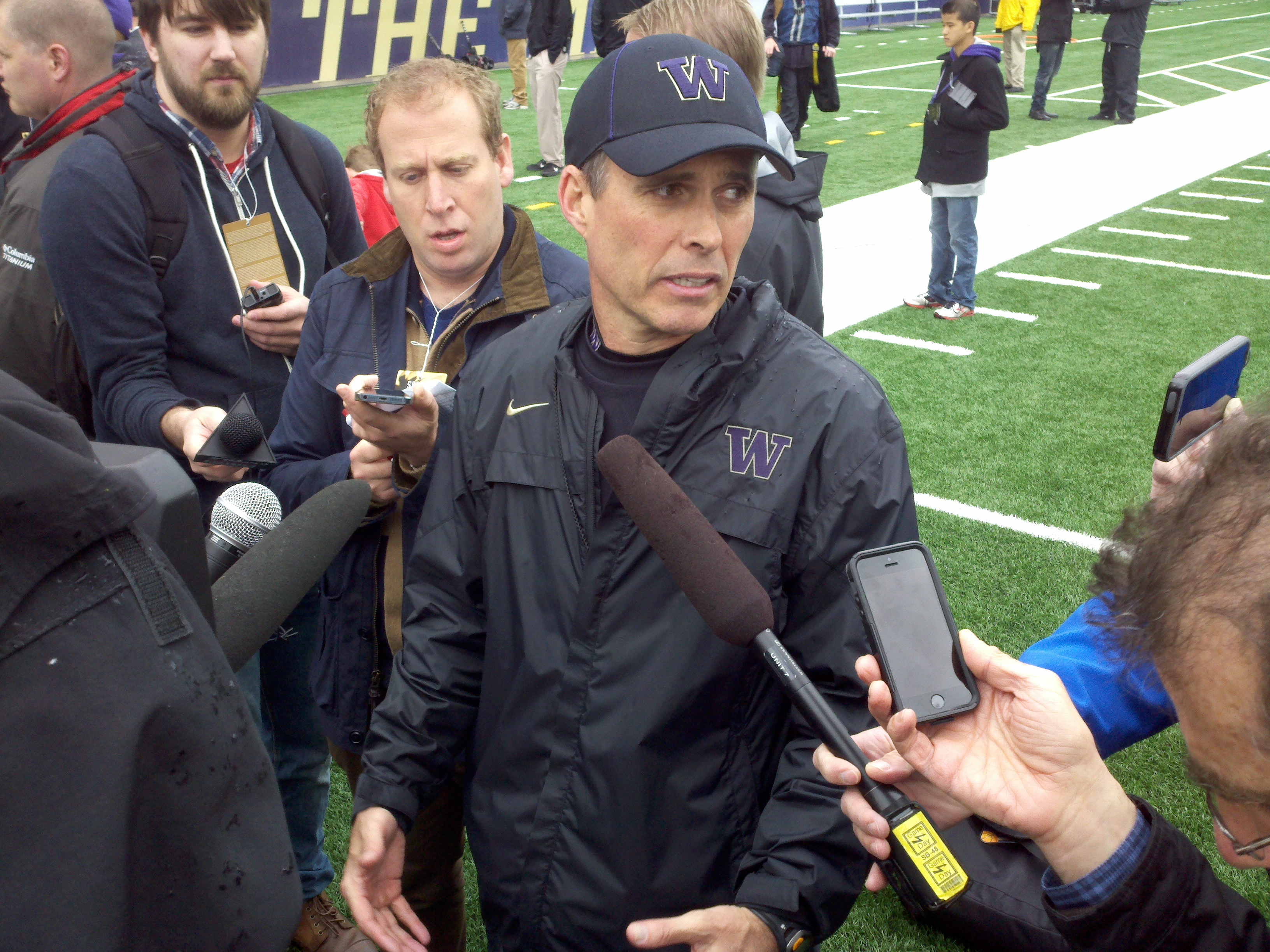 Chris Petersen claims to have no clear idea about who starts at either quartrback or running back. / Art Thiel, Sportspress Northwest