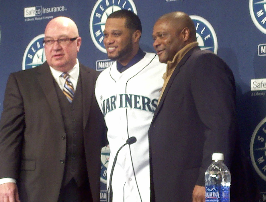 These three men -- Jack Zdurencik, Robinson Cano and Lloyd McClendon -- are standing because their seats are a little too warm. / Art Thiel, Sportspress Northwest
