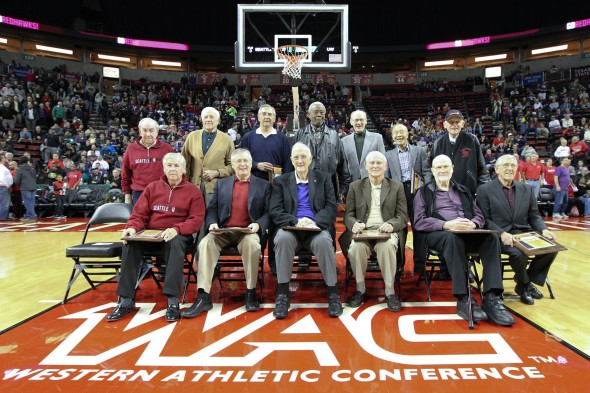 Members of the Seattle U and Washington teams that first played against each other in the 1953 NCAA tourney were honored at halftime of the Huskies-Red Hawks game at KeyArena Thursday night. Seated at front row center is UW star Bob Houbregs, and to his right are twins Eddie and Johnny O'Brien, SU Stars. / Mike Badeau
