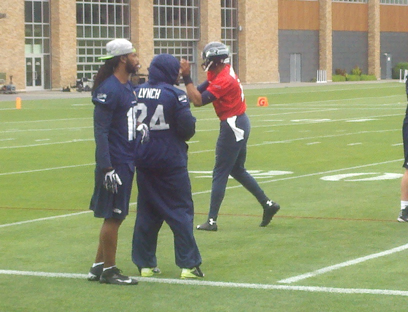 RB Marshawn Lynch, hanging with WR Sidney Rice, was an observer at Seahawks practice Tuesdy. / Art Thiel Sportspress Northwest