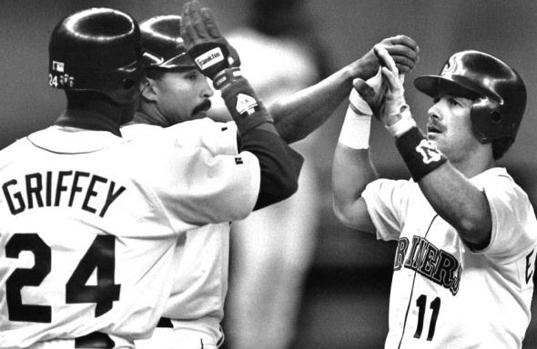 Ken Griffey Jr., left, and Henry Cotto congratulate Edgar Martiinez after he crosses the plate. Martinez won two AL batting titles playing under Piniella. / David Eskenazi Collection