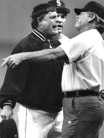 in one of his frequent rants, Piniella goes after umpire John Shulock at the Kingdome in 1993 as Dave Madagan watches. / David Eskenazi Collection
