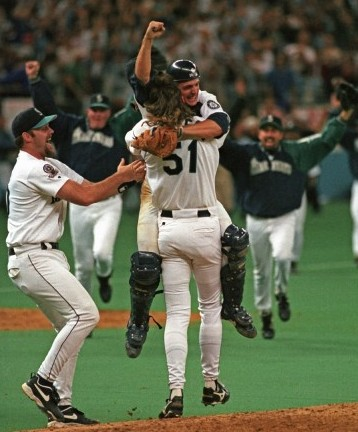 Future Mariners Hall of Famers Randy Johnson (51) and catcher Dan Wilson embrace after Seattle defeated the Angels in a one-game playoff in 1995 at the Kingdome. / Seattle Mariners