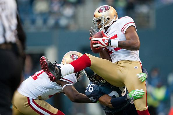 49ers-receiver-michael-crabtree-is-tackled-by-seahawks-defensive-back-josh-wilson
