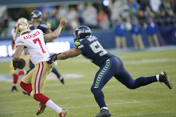 As 49ers QB, Kaepernick was 1-7 against the Seahawks and LB Bobby Wagner. / Drew McKenzie, Sportspress Northwest
