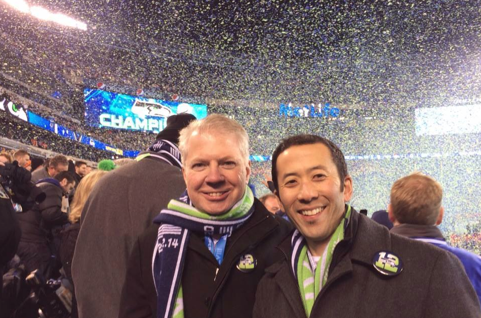 Mayor Ed Murray and husband Michael Shiosaki at a happier moment in Seattle history. / Seahawks.com